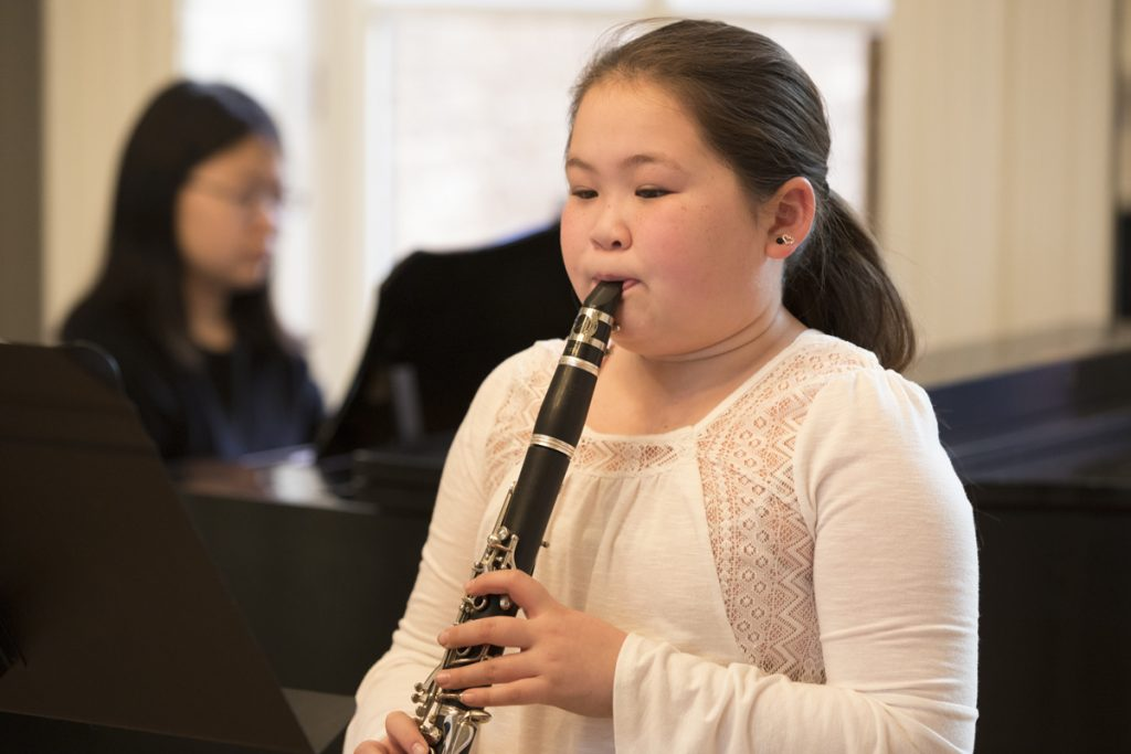Photograph of Baltimore School for the Arts student playing the clarinet
