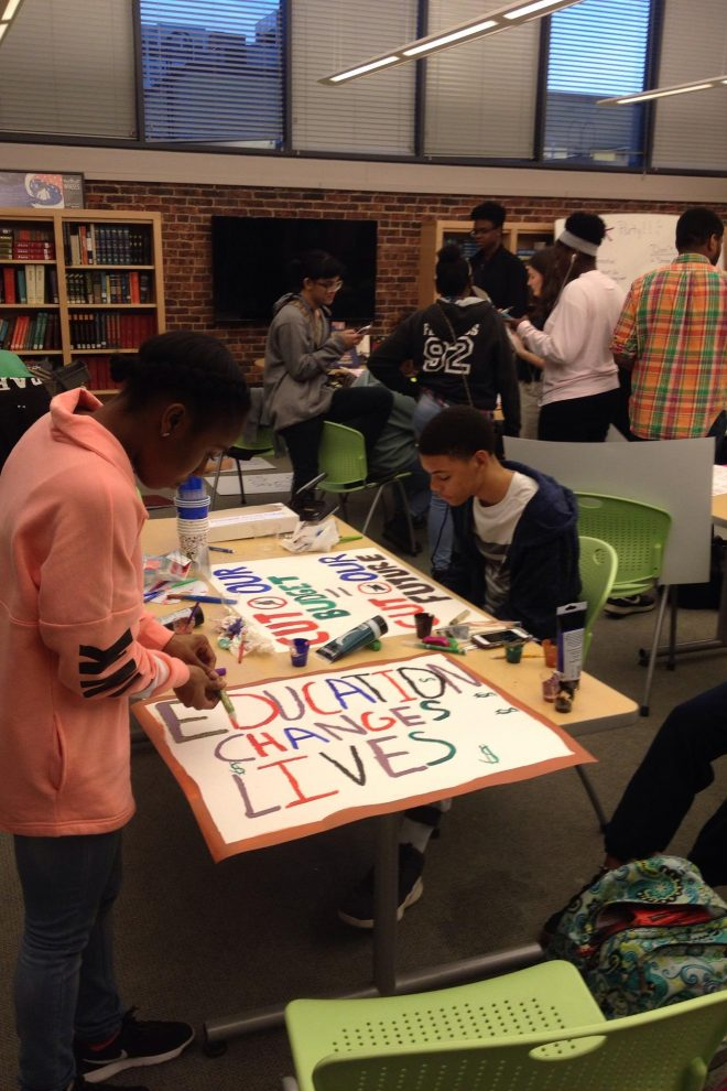 Photograph of Baltimore School for the Arts students making signs for a rally