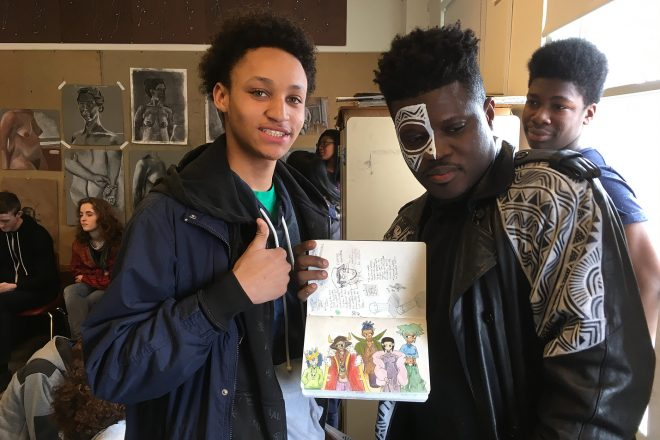 Photograph of Baltimore School for the Arts students showing off their work