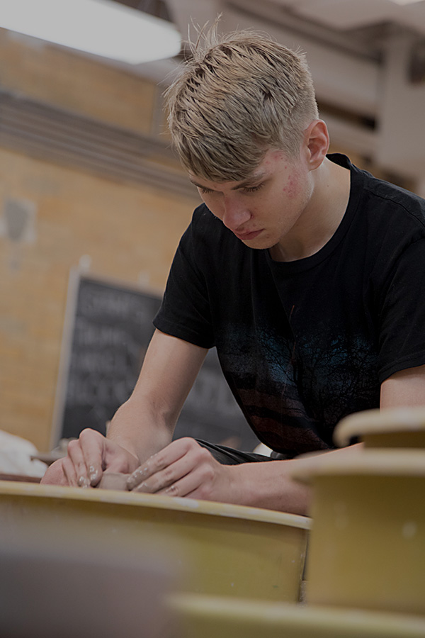 Photograph of Baltimore School for the Arts student working with clay