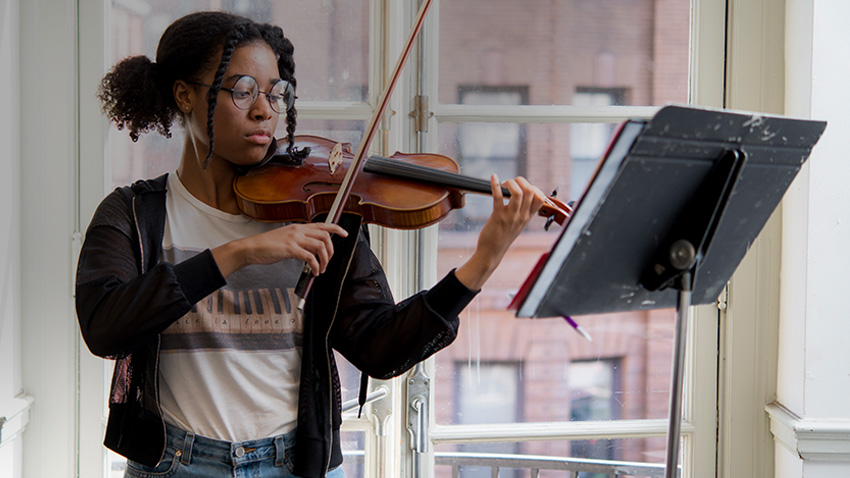 Photograph of Baltimore School for the Arts music student playing violin