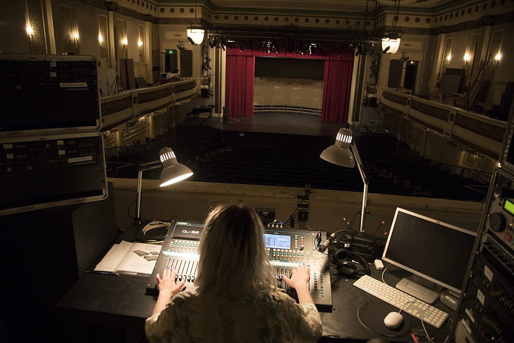 Photograph of a Baltimore School for the Arts theatre student operating stage lighting and sound