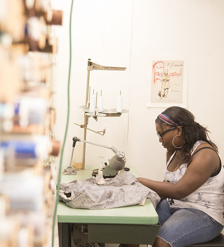 Photograph of a Baltimore School for the Arts student working with textiles