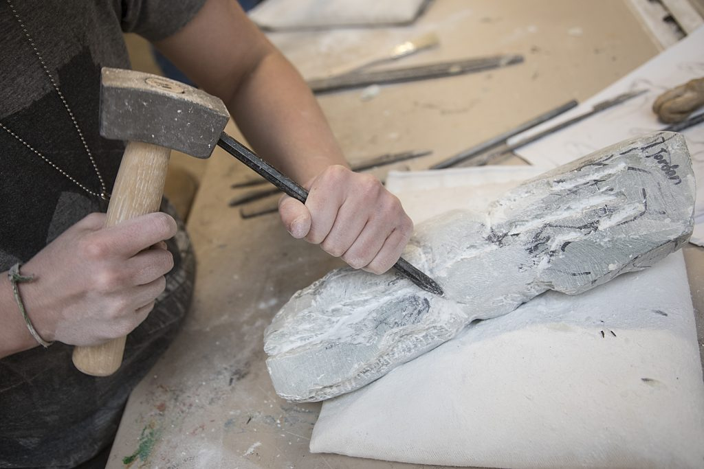 Photographs of Baltimore School for the Arts sculpture student working on a project