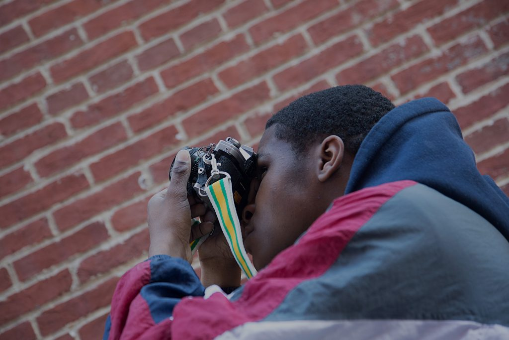 Photographs of Baltimore School for the Arts photography student taking a picture