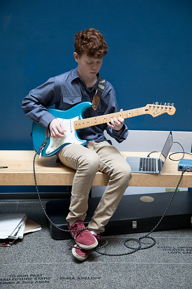 Baltimore School for the Arts student playing guitar