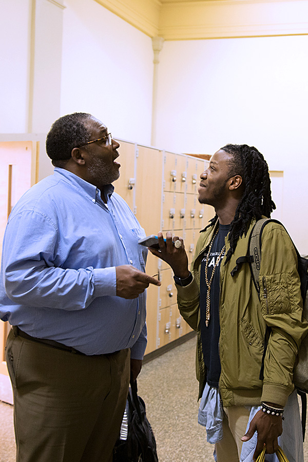 Photograph of Baltimore School for the Arts teacher talking with a student