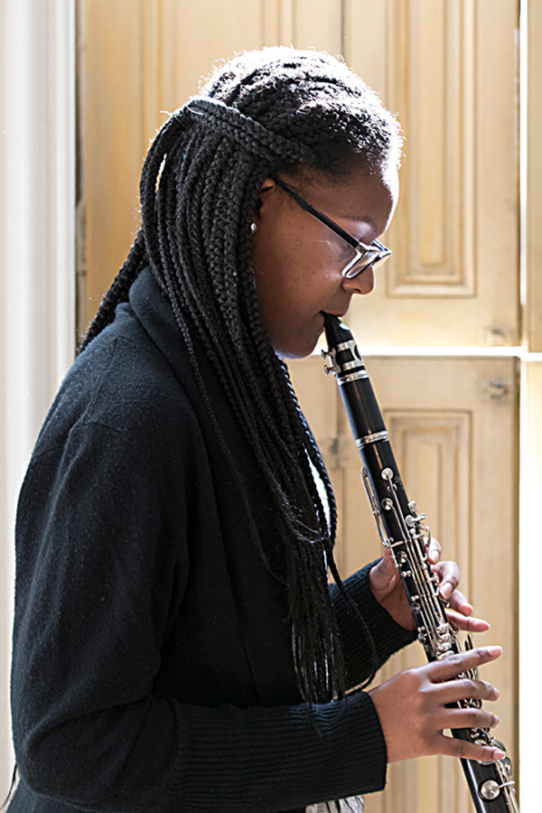 Photograph of Baltimore School for the Arts TWIGS student playing the clarinet