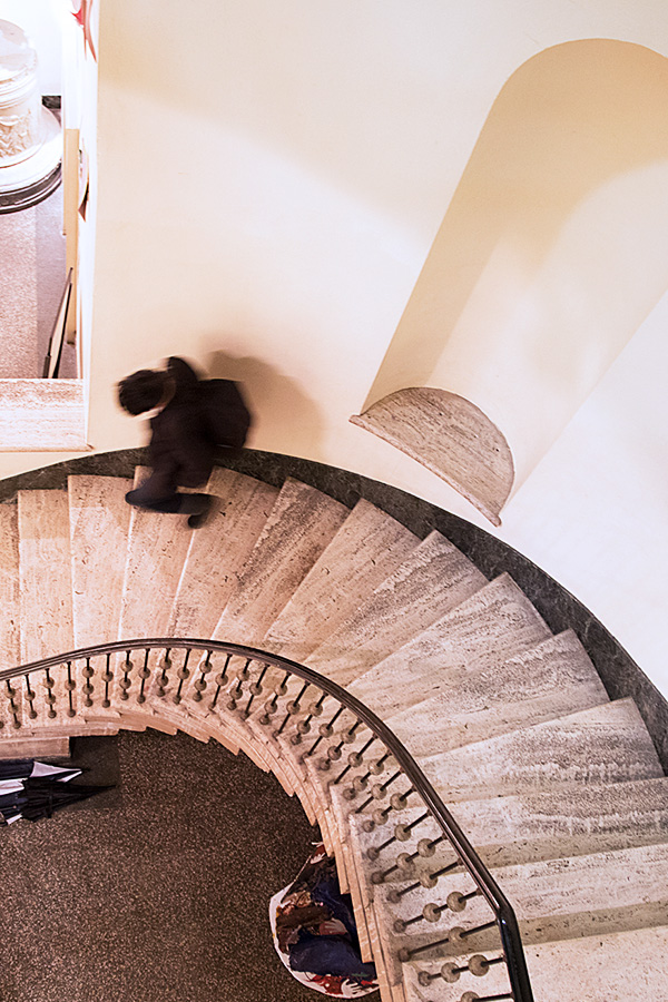 Photograph of student walking down the stairs at Baltimore School for the Arts