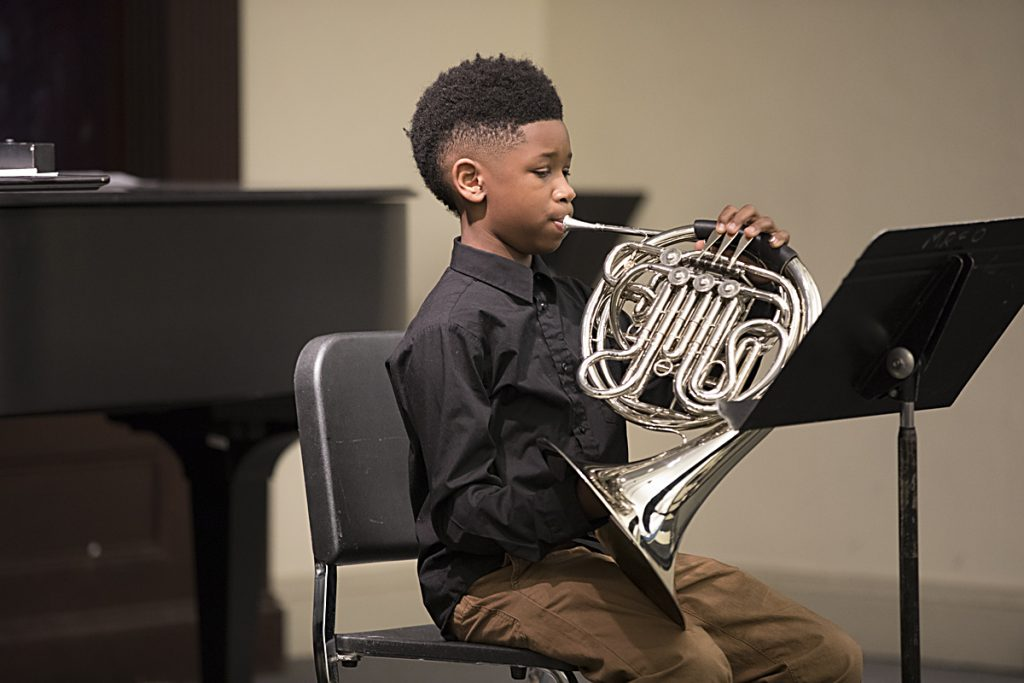 Image of a Baltimore School for the Arts student playing an instrument