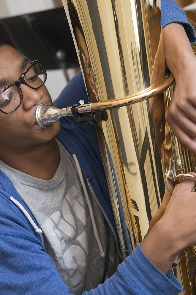 Portrait of student playing the tuba